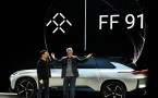 CEO YT Jia and Faraday Future VP of Research and Development Nick Samspson introduces FF 91 at CES 2017.